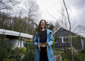 Victoria Plumage holds a stinging nettle in front of Sovereignty Farms on March 7, 2021. Her plan is to plant the stinging nettle and many other plants in the coming months.